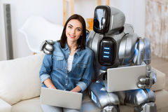 Positive girl and robot bonding to each other Stock Photo
