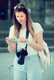 Positive girl  using her phone in the town Stock Image
