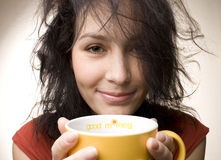Positive girl with yellow cup Stock Images