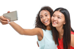 Positive girls making photos Stock Photo