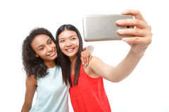 Positive girls making photos Stock Photography