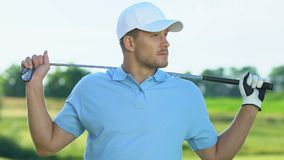 Positive golf player waiting for his competitor, ready to play, leisure activity stock video footage
