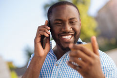 Positive good looking man satisfied with his new credit card Stock Image