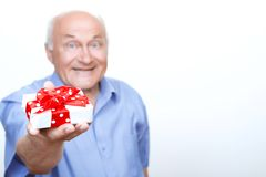 Positive grandfather holding the present Stock Photography