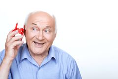 Positive grandfather holding the present Stock Image