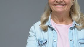 Positive grandmother showing thumbs up, good mood, approval gesture satisfaction. Stock footage stock video footage