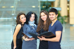 Group of merry students royalty free stock photo
