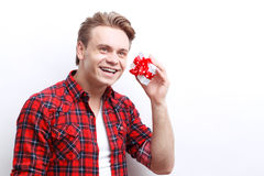 Positive guy holding the present Stock Images