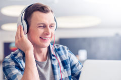 Positive guy listening to music Stock Photos