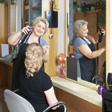 Positive hairdresser at work Stock Photo