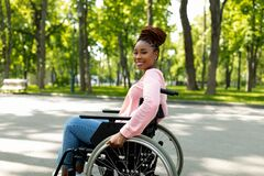 Free Positive Handicapped Black Lady In Wheelchair Enjoying Wonderful Summer Morning Outdoors Royalty Free Stock Photography - 220748387