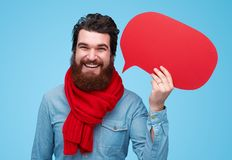 Handsome bearded man with red thinking bubble royalty free stock photos