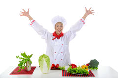 Positive handsome chef prepares vegetables Royalty Free Stock Photo