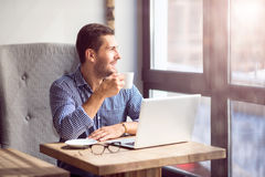 Positive handsome man sitting in the cafe Stock Photo