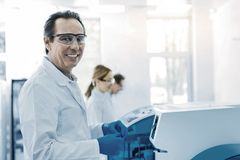 Positive handsome scientist being at work Stock Photo