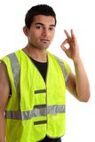 Positive handyman or builder. Ethnic mixed race, blue collar man such as a builder, tradesman, labourer, handyman gestures a positive a-ok approval hand sign Stock Photography