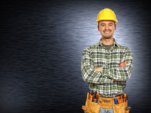 Positive handyman smiling Royalty Free Stock Images