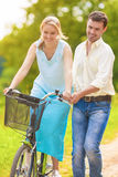 Positive and Happy Caucasian Couple Having Fun Together Riding B Stock Images