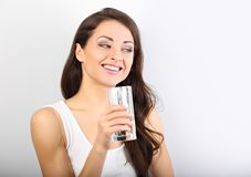 Positive happy woman with healthy skin and long curly hair drink stock photography