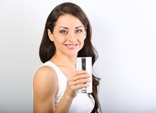 Positive happy woman with healthy skin and long curly hair drink royalty free stock image