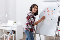 Positive happy woman standing near the whiteboard royalty free stock photography
