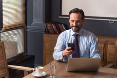Positive hard working manager dialing a telephone number Stock Photography