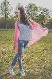 Positive hipster woman in park. Positive beautiful hipster woman in park. Looking at camera. Positive human emotion facial expression body language, concept of Stock Photo