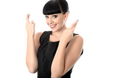 Positive Hopeful Wishful Happy Woman With Fingers Crossed. Positive hopeful wishful happy woman with straight black hair and hispanic or european features Stock Images