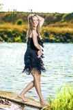 Positive Hot Caucasian Female Dancing on The Pier Outdoors. Havi Royalty Free Stock Photography