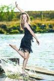 Positive Hot Caucasian Female Dancing on The Pier Outdoors. Havi Stock Photos