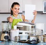 Positive housewife with  appliances  in domestic kitchen Stock Images