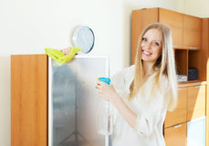 Positive  housewife cleaning  glass Stock Photo