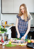 Positive housewife cooking saltwater fish Royalty Free Stock Photo