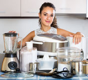 Positive housewife with culinary devices  at kitchen Royalty Free Stock Image