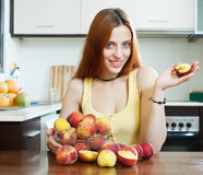 Positive houswife holding peaches Royalty Free Stock Image