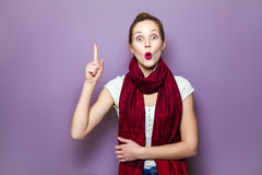 Positive human face expressions, emotions, feelings body language. Idea, portrait happy beautiful woman thinking looking up pointing with finger at blank copy Royalty Free Stock Photography