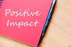 Positive impact write on notebook Stock Image