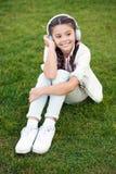 Positive influence of music. Child girl enjoying music modern earphones. Childhood and teenage music taste. Little girl. Listening music enjoy favorite song royalty free stock photography