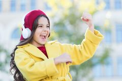 Positive influence of music. Child girl french style outfit enjoying music. Childhood and teenage music taste. Little. Girl listening music enjoy favorite song royalty free stock image