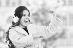 Positive influence of music. Child girl french style outfit enjoying music. Childhood and teenage music taste. Little. Girl listening music enjoy favorite song stock photos