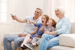 Positive inspiring couple having a lovely weekend with their grandchildren. Intriguing episode. Charming active enthusiastic grandparents enjoying kids company stock photos