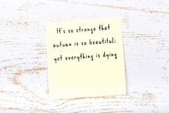 Positive inspiring quote handwritten on sticky note on wooden background stock images