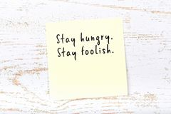 Positive inspiring quote handwritten on sticky note on wooden background stock photos