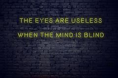 Positive inspiring quote on neon sign against brick wall the eyes are useless when the mind is blind vector illustration
