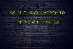 Positive inspiring quote on neon sign against brick wall good things happen to those who hustle stock illustration