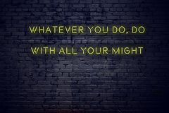 Positive inspiring quote on neon sign against brick wall whatever you do do with all your might stock image