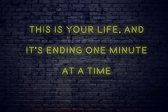 Positive inspiring quote on neon sign against brick wall this is your life and its ending one minute at a time royalty free stock photos