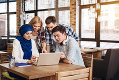 Positive international students working together Royalty Free Stock Photo