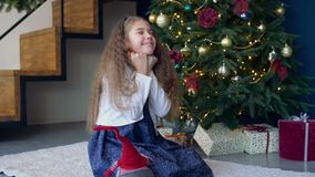 Joyful dreamy girl making a wish for christmas stock footage