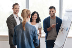 Positive joyful people looking at their manager Stock Image